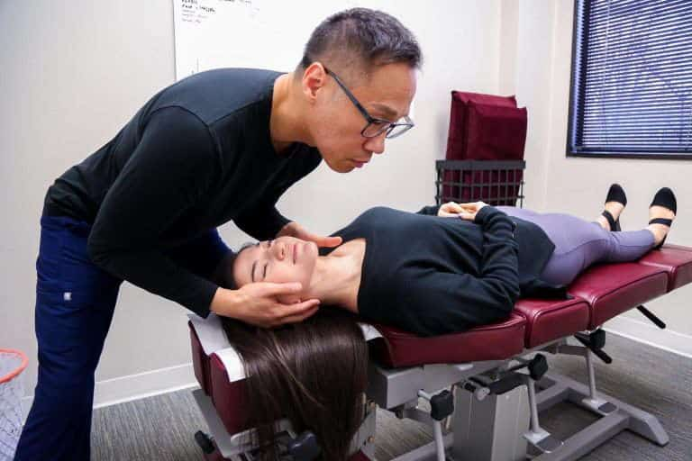Dr. Gregory Lee adjusting a Patient in Active Family wellness Fairfax Chiropractor